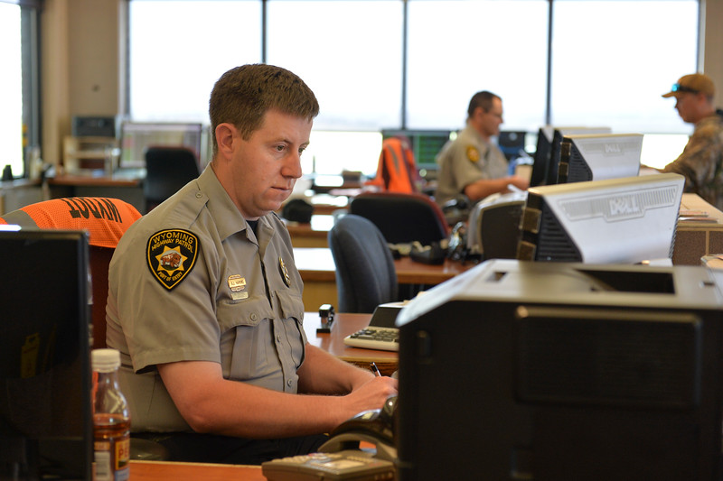 Justin Sheely | The Sheridan Press<br /> Lead Officer Andy Harkins works at his station at the Wyoming Port of Entry north of Sheridan Wednesday, May 9, 2018.