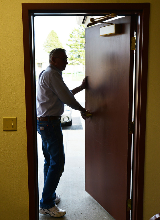 City of Dayton Mayor Robert Wood exits through the door at his office at City Hall in Dayton Tuesday, April 22, 2014. Wood will not be seeking re-election at the end of this year. Wood has been serving as Mayor for 16-years. The Sheridan Press|Justin Sheely