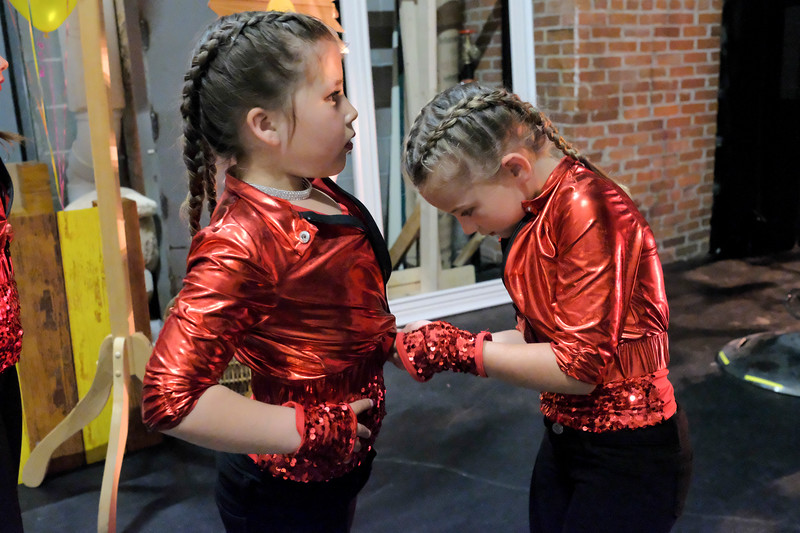 "Justin Sheely | The Sheridan Press<br /> Sapphire dancers Aliegh Tellez, left, and Gabby Springsteen make final costume adjustments before their performance during a rehearsal for Donna's Dance Academy ""United Through Dance"" show Thursday at the WYO Theater. The event shows Friday and Saturday at 6p.m. and 8p.m."