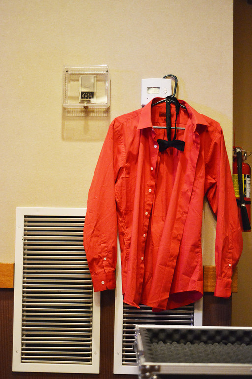 Lancifer's distinctive red shirt is hung on a thermostat during setup.