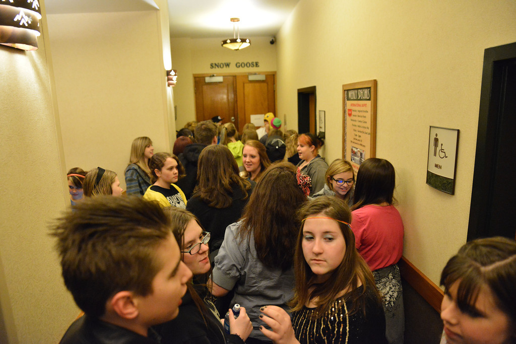 Young fans crowd around before the doors open Friday night at the Best Western Sheridan Center.