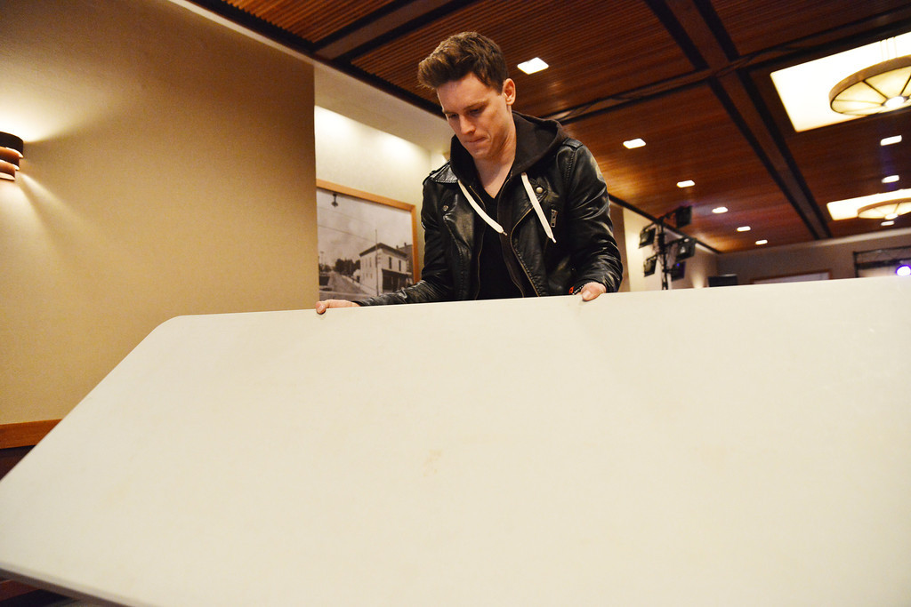Lancifer opens a folding table for merchandise sales during setup Friday.