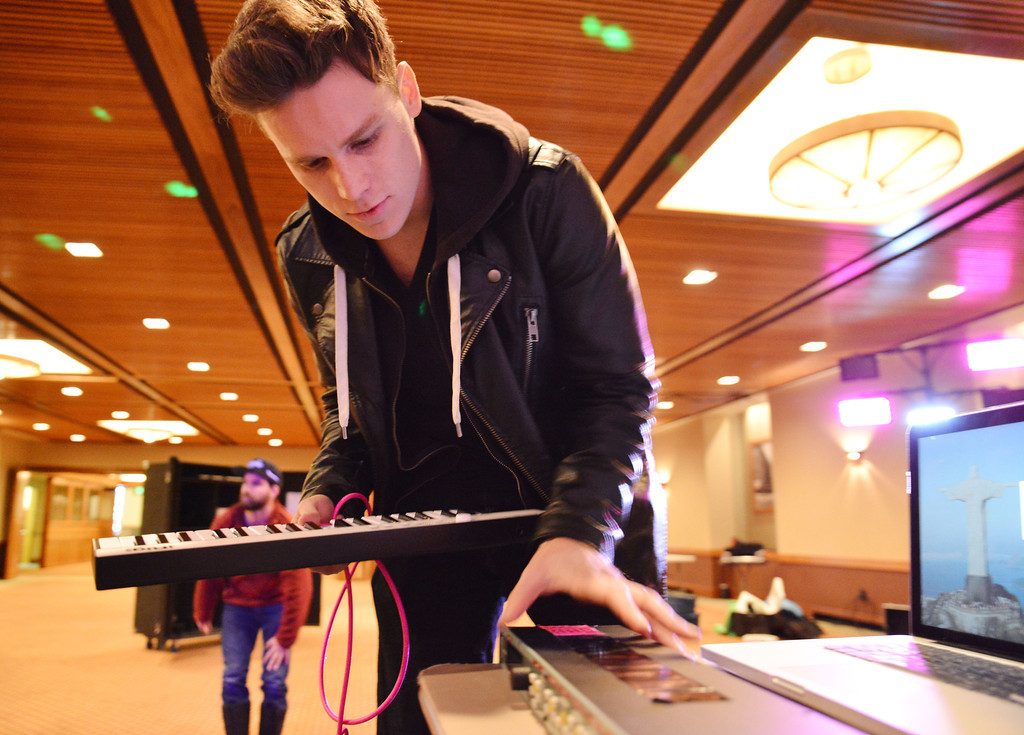 Lancifer plugs in his audio gear before his hometown concert Friday at the Best Western Sheridan Center.