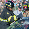 """Goose Valley Volunteer fireman Doug Swaney cuts the windshield of the car with the trapped occupants inside during the """"Last Call,"""" a mock motor vehicle accident on Friday at the Sheridan High School."""
