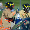 Sheridan Fire-Rescue Chad Brutlag, left, uses the Jaws of Life to rip off a door with Andrew Lindberg during a mock motor vehicle accident Friday at the Sheridan High School.