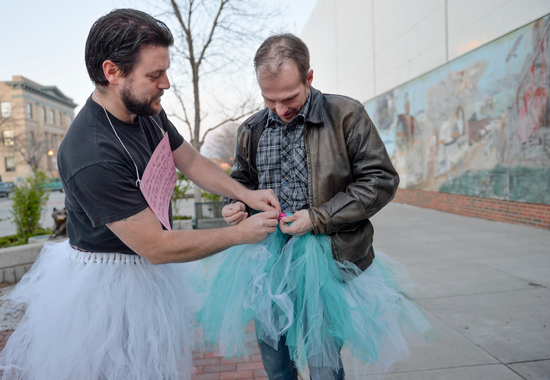 "Justin Sheely | The Sheridan Press<br /> David Myers, left, and Bill Matteson put on tutus before visiting various bars along Sheridan's Main Street for the ""Live and Let Tutu"" response Saturday night. Sheridan residents took part in a state-wide response to comments made by U.S. Sen. Mike Enzi, R-Wyoming, to middle school students in Greybull on April 20, when he was asked about federal protections for LGBT people. The senator reportedly said that he knows a guy who wears a tutu to bars and and always surprised that he gets in fights, ""he kind of asks for it a little bit."" Enzi said."