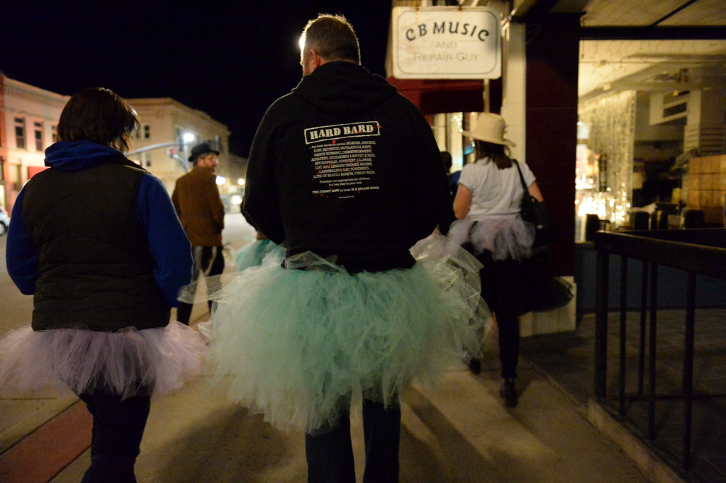 "Justin Sheely | The Sheridan Press<br /> Tutu-wearing activists walk along Sheridan's Main Street during the ""Live and Let Tutu"" response Saturday night. Sheridan residents took part in a state-wide response to comments made by U.S. Sen. Mike Enzi, R-Wyoming, to middle school students in Greybull on April 20, when he was asked about federal protections for LGBT people. The senator reportedly said that he knows a guy who wears a tutu to bars and and always surprised that he gets in fights, ""he kind of asks for it a little bit."" Enzi said."