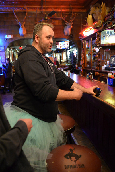 "Justin Sheely | The Sheridan Press<br /> Aaron Odom orders a drink during the ""Live and Let Tutu"" response Saturday night at the Mint Bar in Sheridan. Sheridan residents took part in a state-wide response to comments made by U.S. Sen. Mike Enzi, R-Wyoming, to middle school students in Greybull on April 20, when he was asked about federal protections for LGBT people. The senator reportedly said that he knows a guy who wears a tutu to bars and and always surprised that he gets in fights, ""he kind of asks for it a little bit."" Enzi said."