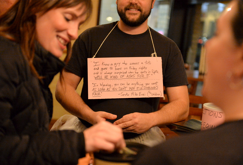 "Justin Sheely | The Sheridan Press<br /> Guests make donations to Wyoming Equality as tutu-wearing activists visit for the ""Live and Let Tutu"" response Saturday night at Frackelton's. Sheridan residents took part in a state-wide response to comments made by U.S. Sen. Mike Enzi, R-Wyoming, to middle school students in Greybull on April 20, when he was asked about federal protections for LGBT people. The senator reportedly said that he knows a guy who wears a tutu to bars and and always surprised that he gets in fights, ""he kind of asks for it a little bit."" Enzi said."