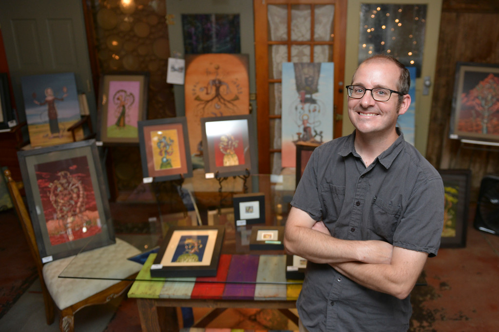 Justin Sheely | The Sheridan Press<br /> Local artist Andy Robbins stands by his artwork during a book signing Thursday at Gina's Gallery in Dayton.