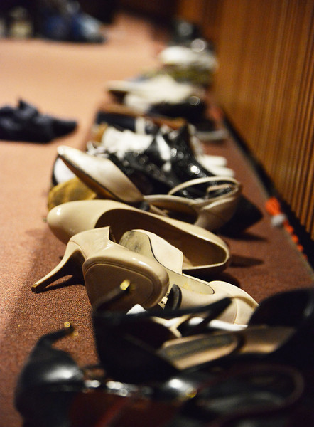 A selection of vintage shoes lay on the floor for the students to try on.