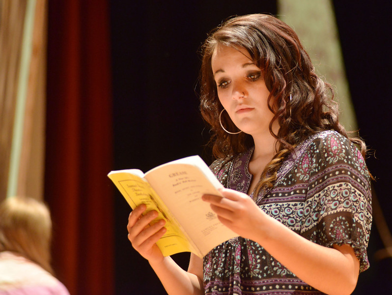 Natalie Magera refers to the playbook during a rehearsal for the production of 'Grease' Tuesday, Feb, 11, 2014, at the Sheridan High School Sue Henry auditorium.