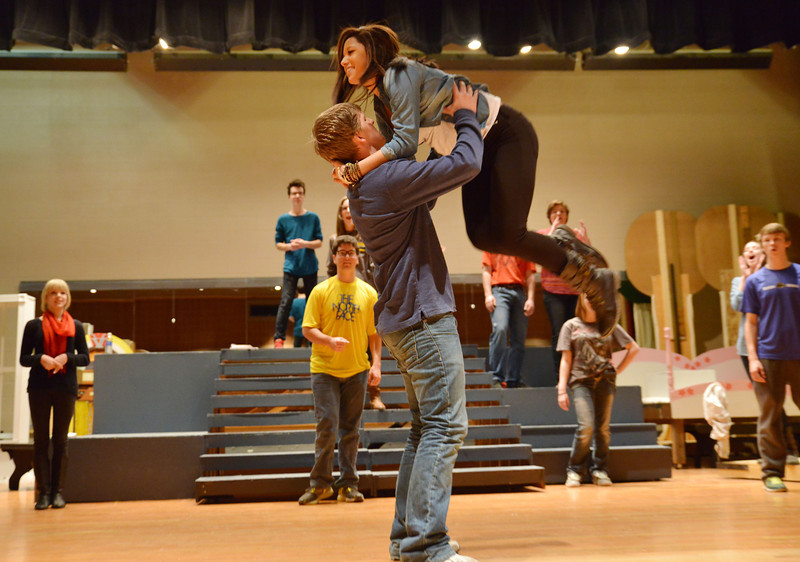 Becky Bridger, as Rizzo, and Adam Popke, as Kenickie practice jitterbug moves for 'Grease' Tuesday, Feb, 11, 2014, at the Sheridan High School Sue Henry auditorium.