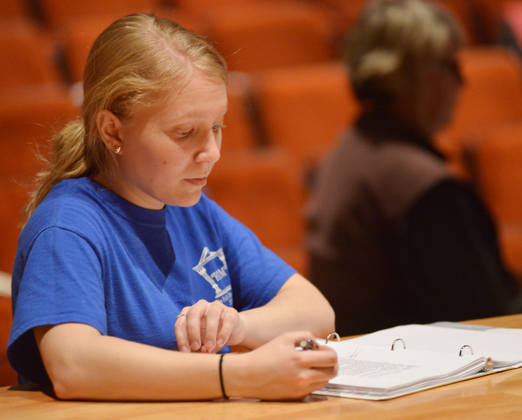 Stage Manager Mona Tescher follows the book as the students run through their lines during a rehearsal of 'Grease' Tuesday, Feb, 11, 2014, at the Sheridan High School Sue Henry auditorium.