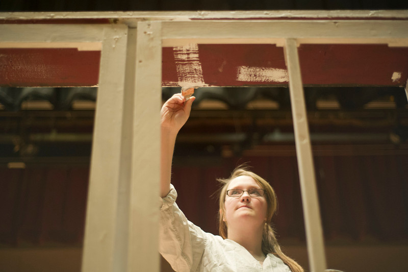Carson Holwell brushes paint a stage set Saturday, Jan. 25, 2014 at Sheridan High School.