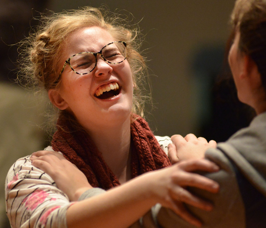 Micah Cornell laughs during a dance number practice for 'Grease' Tuesday, Feb, 11, 2014, at the Sheridan High School Sue Henry auditorium.
