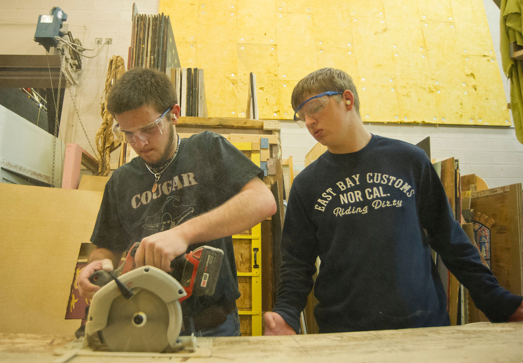 Mikael Meek, left, cuts a sheet of plywood for a stage set with Adam Popke during preparations for the production of 'Grease' Saturday, Jan. 25, 2014 at Sheridan High School.