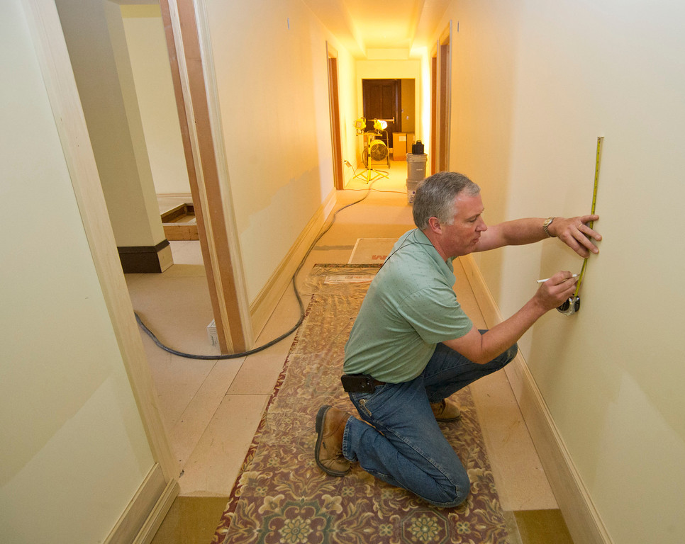 Carpenter Donald Conklin marks the wall with the help of a laser level for the wainscot that will be installed in the hallway on the second floor of the North wing Wednesday at the historic Sheridan Inn. The Sheridan Inn was purchased by Bob and Dana Townsend in Fall of 2013 after the historical site went into foreclosure for more than a year. The Townsends have been finishing the renovations which began with the previous organization. The North wing of the second floor is scheduled to be finished by March. Dry wall work is expected to be done in the next 3 to 4 weeks on the South wing of the second floor and the entire third floor. Fine carpentry and finishing work will follow the dry wall work. In April, Sheridan Inn owner Bob Townsend will determine a timeline for the availability of the rooms to be made available to the public. The Sheridan Inn will have 22 rooms once the reconstruction is complete. (The Sheridan/Justin Sheely)