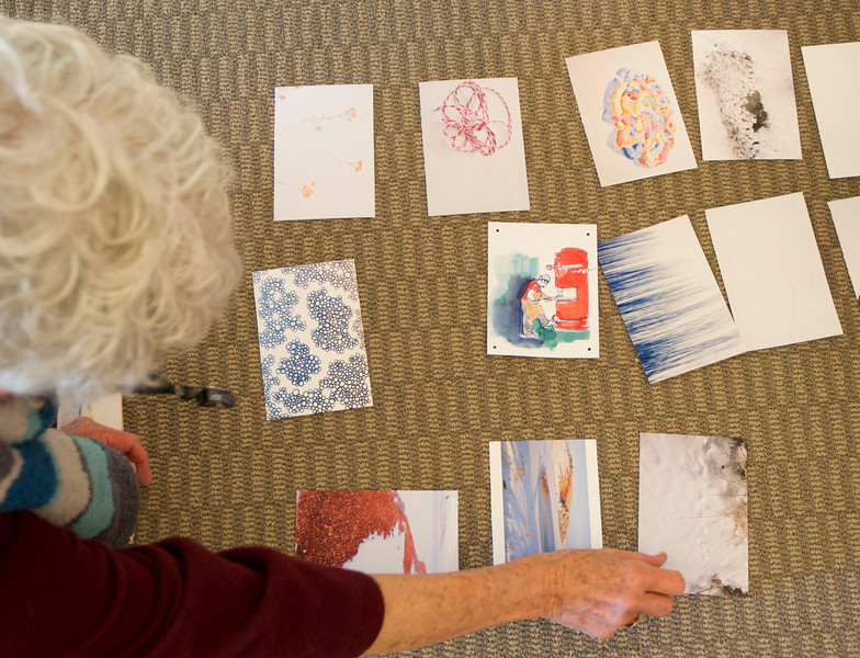 Cards are arranged on the floor before they are tied together Tuesday at the Sheridan Community Art Center in the Historic Train Depot. The Beast is a collaborative effort from five former Jentel Foundation residents to interpret what 'beast' means and how it should be expressed.