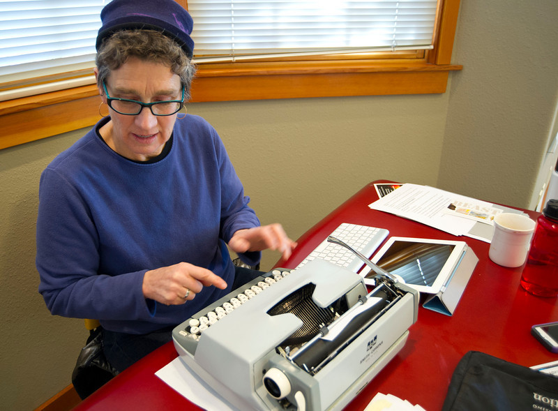 "Writer Lucy Jane Bledsoe types a short story on a card using a typewriter during the building of ""The Beast"" project Tuesday at the Sheridan Community Art Center in the Historic Train Depot. The Beast is a collaborative effort from five former Jentel Foundation residents to interpret what 'beast' means and how it should be expressed."