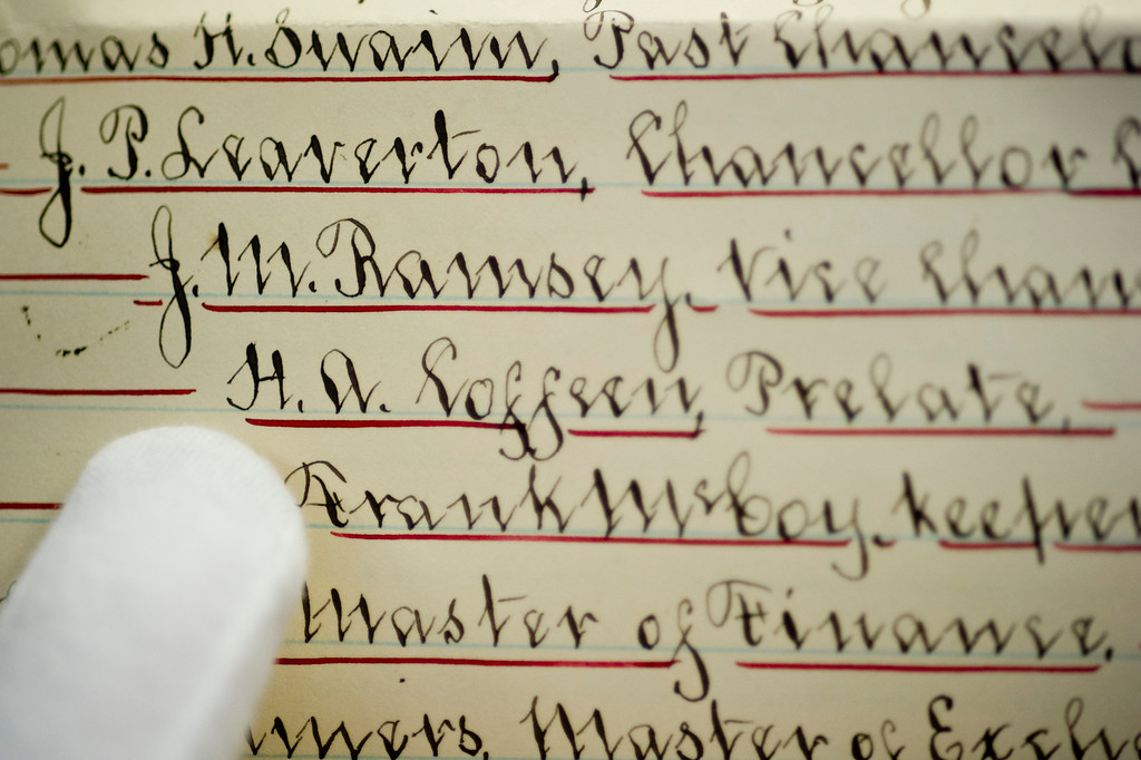 Slack points out Henry A. Coffeen's name in the list of Sheridan Lodge's officers found in the time capsule of THE Wyoming Room at the Sheridan County Fulmer Public Library.