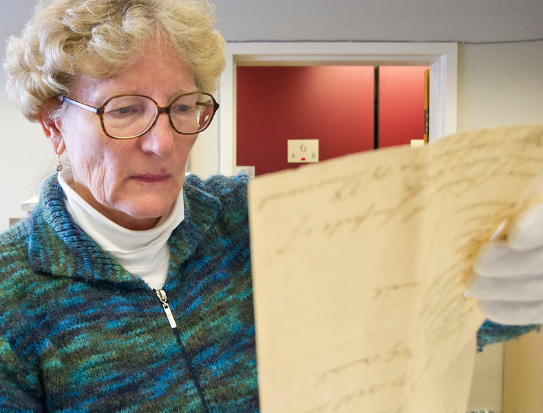 Director of THE Wyoming Room Judy Slack pulls reads a document found in the time capsule Tuesday at the Sheridan County Fulmer Library.