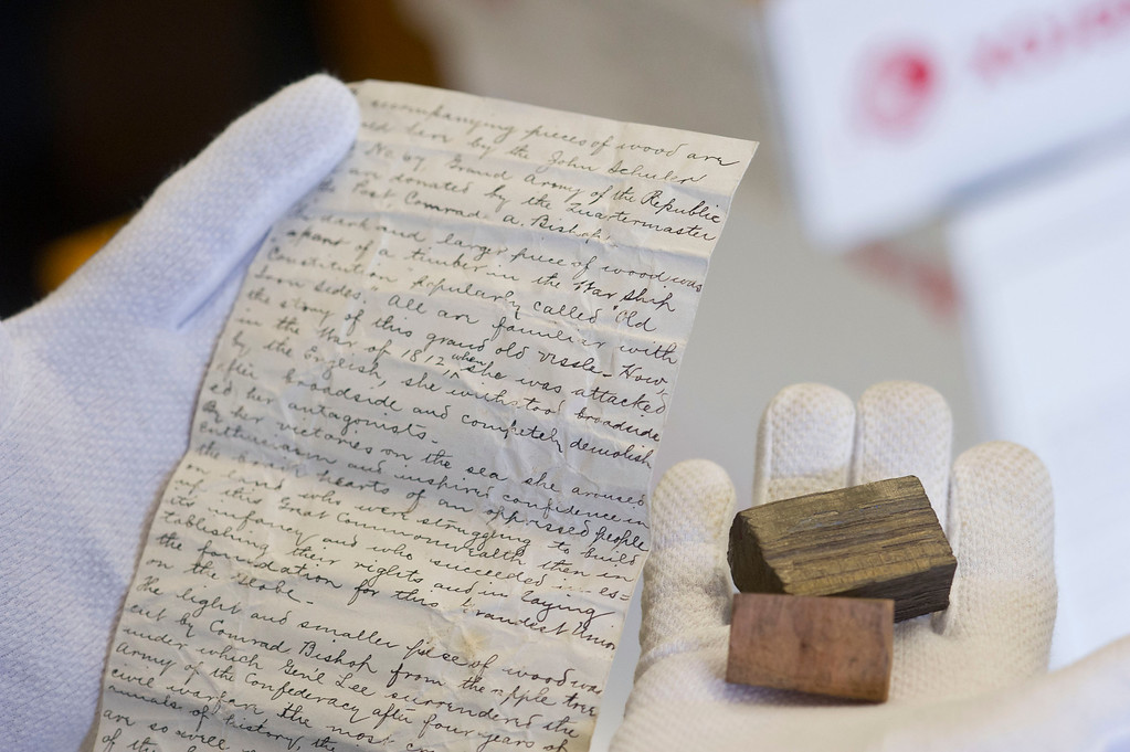 Judy Slack holds a letter explaining the origins of the two pieces of wood found in the time capsule, which was placed there during a Masonic cornerstone ceremony at Central School in 1891. According to the note found in the box, the dark piece of wood was from USS Constitution, a Navy frigate that fought during the war of 1812. The lighter color wood is believed to be from an apple tree at Appomattox where General Lee received a letter from at the conclusion of the American Civil War.