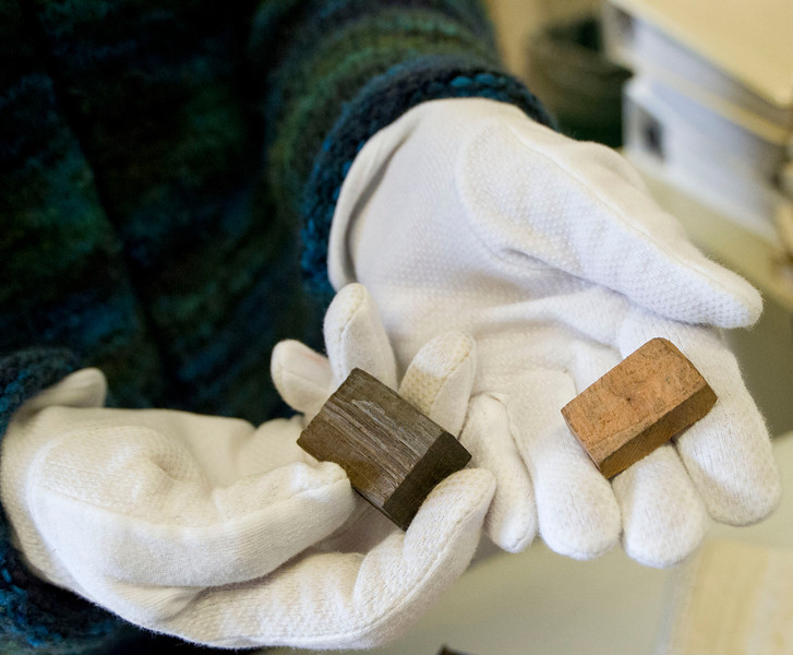 Judy Slack holds the two pieces of wood found in the time capsule, which was placed there during a Masonic cornerstone ceremony at Central School in 1891. According to the note found in the box, the dark piece of wood was from USS Constitution, a Navy frigate that fought during the war of 1812. The lighter color wood is believed to be from an apple tree at Appomattox where General Lee received a letter from at the conclusion of the American Civil War.