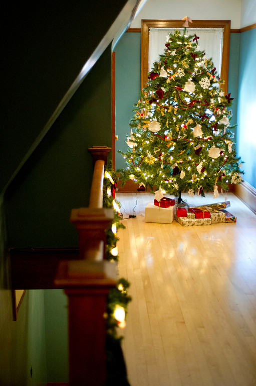 One of the more humble Christmas trees is seen in the hallway of the servant's quarters on the top floor of the Kendrick Mansion Trail End museum.