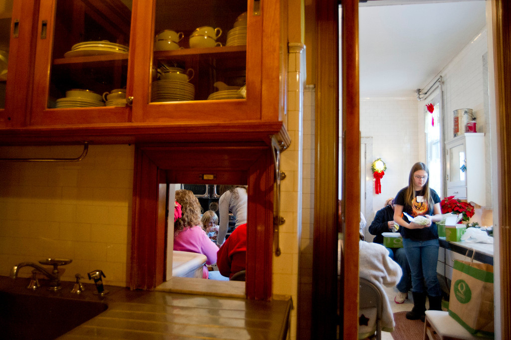 Volunteers take a lunch break in the kitchen Saturday at the Kendrick Mansion Trail End museum.
