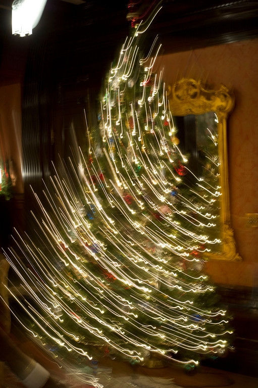 A Chrismas tree lights up the living room Friday night during the Trail End Holiday Open House at Kendrick Mansion.