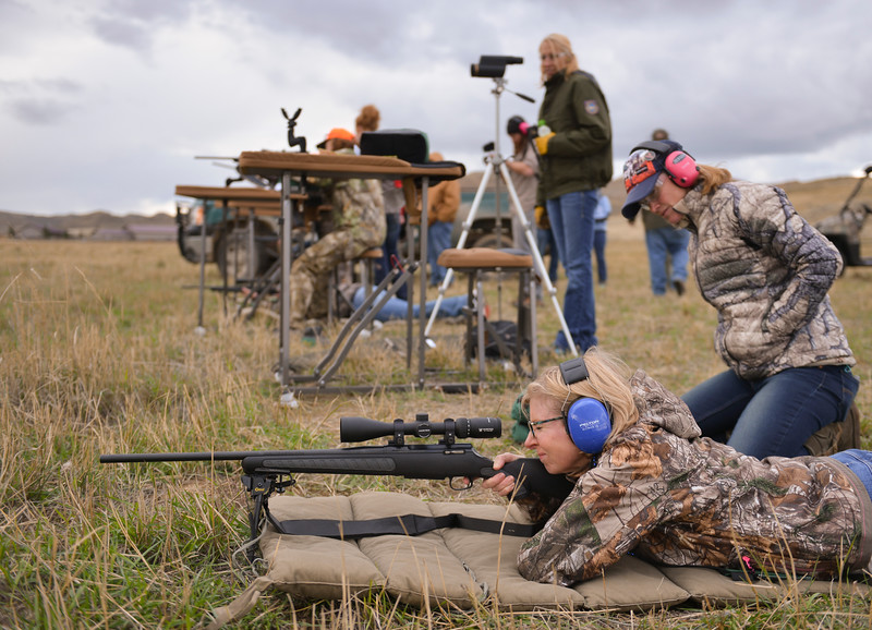 Justin Sheely | The Sheridan Press<br /> Andrea Jordan of Houston, Texas, squeezes the trigger as Gloria Courser of Jackson Hole, Wyoming, right, offers advice during a rifle sight-in for the annual Wyoming Women's Antelope Hunt at a private ranch near Ucross.