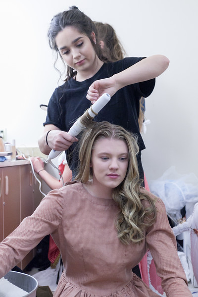 Tibby McDowell | The Sheridan Press<br /> Aliya Gaona curls Kalie Bocek's hair in the girls dressing room backstage of the production of Beauty and the Beast at Tongue River High School Auditorium Tuesday, March 6, 2018.