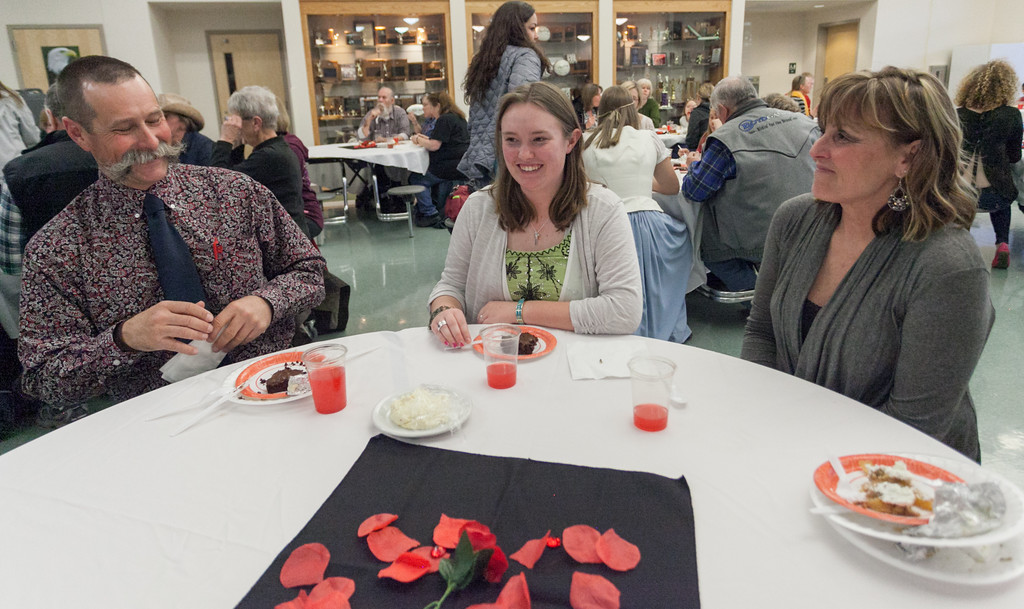 Tibby McDowell | The Sheridan Press<br /> Martin Anseth, left, his daughter NataLee, center, and wife Melanie enjoy the dinner served to attendees prior to the production of Beauty and the Beast at Tongue River High School Auditorium Tuesday, March 6, 2018.