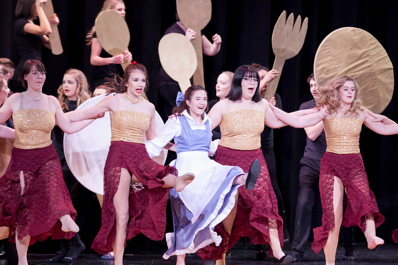 "Tibby McDowell | The Sheridan Press<br /> From left, Anastasia Beutler, Holly Hutchinson, Nikki Perfetti, Angelina Bird, and Lexi Bernard dance during the ""Be Our Guest"" song during the production of Beauty and the Beast at Tongue River High School Auditorium Tuesday, March 6, 2018."