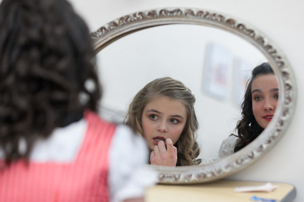 Tibby McDowell | The Sheridan Press<br /> Grace Sopko, left, and Izzy Carbert perfect their lipstick backstage prior to the production of Beauty and the Beast at Tongue River High School Auditorium Tuesday, March 6, 2018.