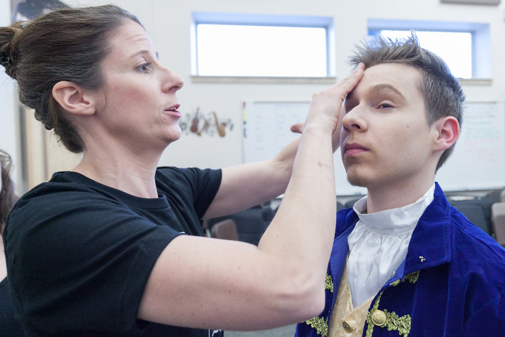 Tibby McDowell | The Sheridan Press<br /> Joy McArthur, left, puts make-up on Loren Harrington backstage during preparations of the production Beauty and the Beast at Tongue River High School Auditorium Tuesday, March 6, 2018.