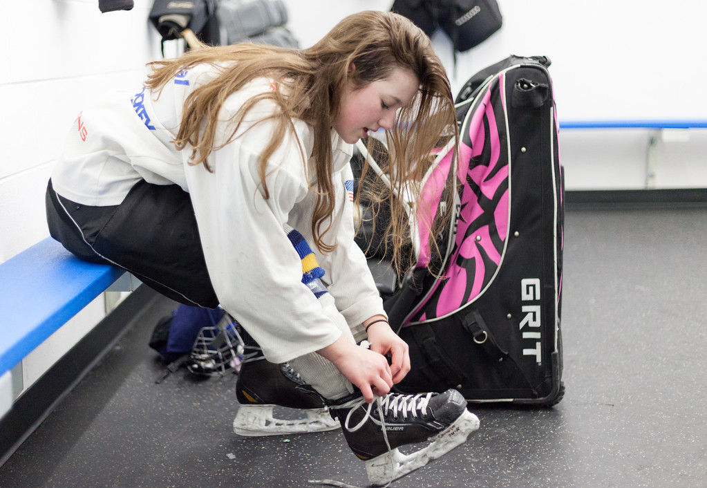 Tibby McDowell | The Sheridan Press<br /> Camdyn Cook unlaces her skates in an empty locker room after practice at Whitney Rink at the M&M's Center Tuesday Feb. 20, 2018.
