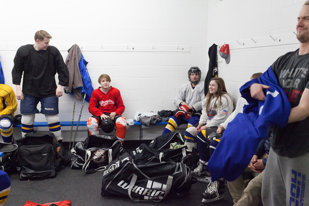 Tibby McDowell | The Sheridan Press<br /> Camdyn Cook hangs out in the boys locker room during a team meeting prior to practice at Whitney Rink at the M&M's Center Tuesday Feb. 20, 2018.