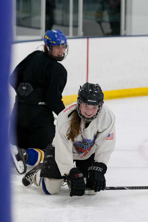 Tibby McDowell | The Sheridan Press<br /> Camdyn Cook gets a friendly hockey check from LJ Bailey during practice at Whitney Rink at the M&M's Center Tuesday Feb. 20, 2018.