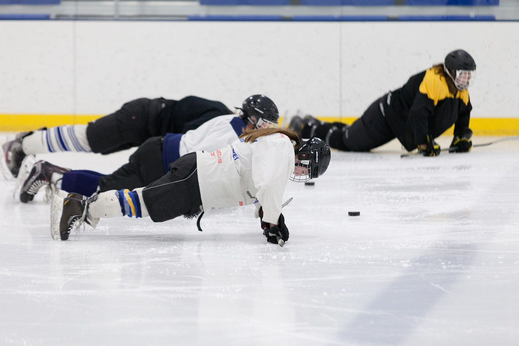 Tibby McDowell | The Sheridan Press<br /> Being a girl doesn't give you special treatment on the Sheridan Hawk's hockey team.  Camdyn Cook does push-up's alongside her teammates on the ice during warm up's at Whitney Rink at the M&M's Center Tuesday Feb. 20, 2018.
