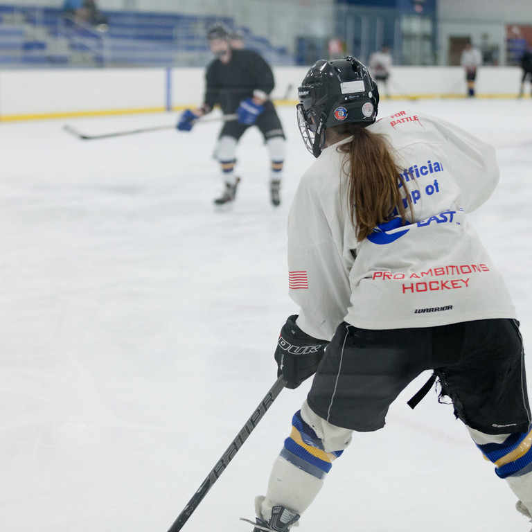 Tibby McDowell   The Sheridan Press<br /> The long ponytail hanging down the back of her jersey is one of the only ways to know that it's Camdyn Cook on the ice, the only female on the Sheridan Hawks hockey team during practice at Whitney Rink at the M&M's Center Tuesday Feb. 20, 2018.