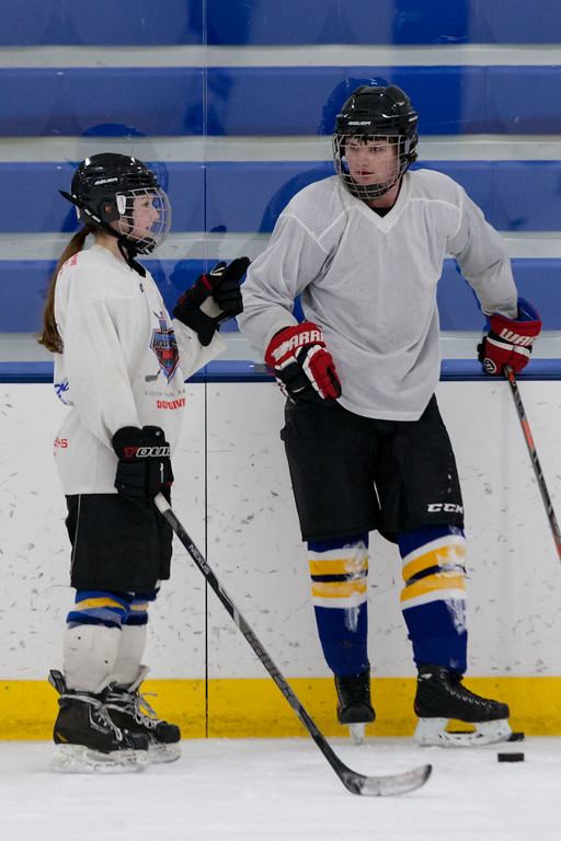 Tibby McDowell | The Sheridan Press<br /> Camdyn Cook chats with Gunnar Swanson during practice at Whitney Rink at the M&M's Center Tuesday Feb. 20, 2018.
