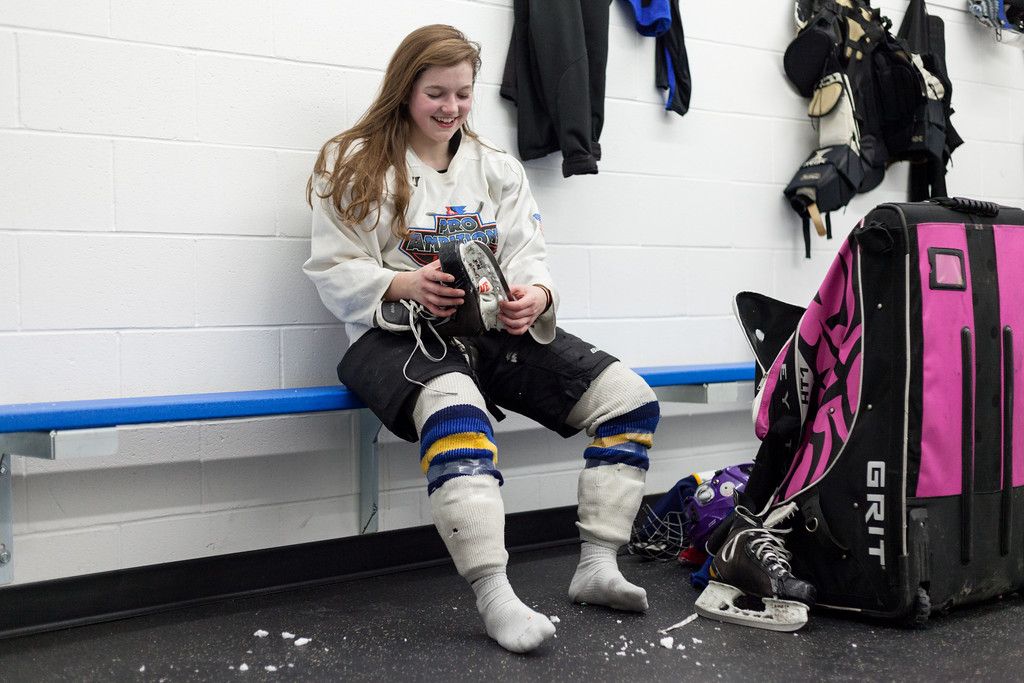 Tibby McDowell | The Sheridan Press<br /> Camdyn Cook removes ice from her skate in an empty locker room after practice at Whitney Rink at the M&M's Center Tuesday Feb. 20, 2018.