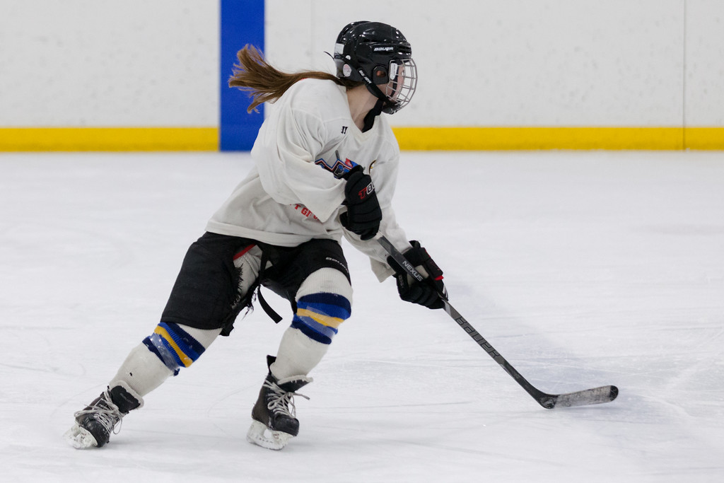 Tibby McDowell | The Sheridan Press<br /> The long ponytail hanging down the back of her jersey is one of the only ways to know that it's Camdyn Cook on the ice, the only female on the Sheridan Hawks hockey team during practice at Whitney Rink at the M&M's Center Tuesday Feb. 20, 2018.