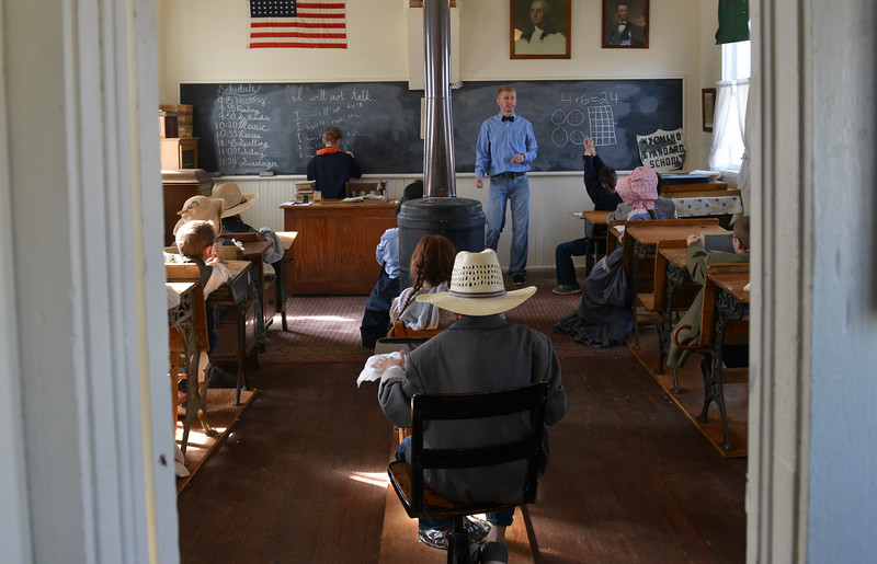 Justin Sheely | The Sheridan Press<br /> Second-grade teacher Jesse Hinkhouse instructs the students during a historic social studies lesson at the Owen School in Ranchester Tuesday, April 10, 2018. Tongue River and Big Horn elementary students experienced the teaching and disciplinary methods of the classroom of 100 years ago in the historic one-room schoolhouse.