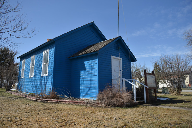 Justin Sheely | The Sheridan Press<br /> The Owen School, also known as the little blue schoolhouse, stands outside of the former Tongue River Elementary School building in Ranchester Tuesday, April 10, 2018. Tongue River and Big Horn elementary students experienced the teaching and disciplinary methods of the classroom of 100 years ago in the historic one-room schoolhouse.