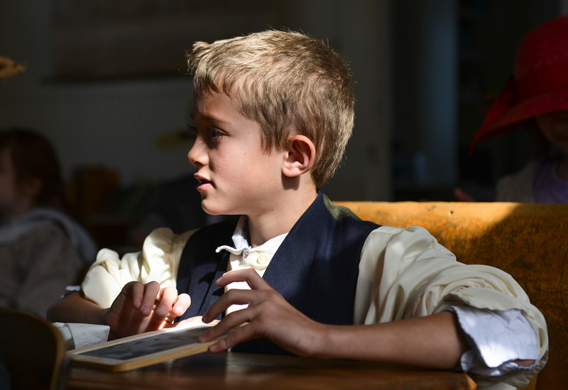 Justin Sheely   The Sheridan Press<br /> Second-grader Aiden Smith looks on as the teacher gives instruction during a historic social studies class at the Owen School in Ranchester Tuesday, April 10, 2018. Tongue River and Big Horn elementary students experienced the teaching and disciplinary methods of the classroom of 100 years ago in the historic one-room schoolhouse.