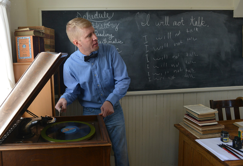 Justin Sheely | The Sheridan Press<br /> Jesse Hinkhouse demonstrates a hand-crank vinyl record player during a historic social studies class at the Owen School in Ranchester Tuesday, April 10, 2018. Tongue River and Big Horn elementary students experienced the teaching and disciplinary methods of the classroom of 100 years ago in the historic one-room schoolhouse.