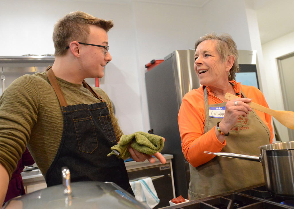 Justin Sheely | The Sheridan Press<br /> Guest instructor and nutritionist Jack Achenbach of Philadelphia, Tennessee, left, shares with Carolyn Kaiser during a cooking class at Verdello Olive Oils & Fine Foods in Sheridan Wednesday, March 21, 2018.